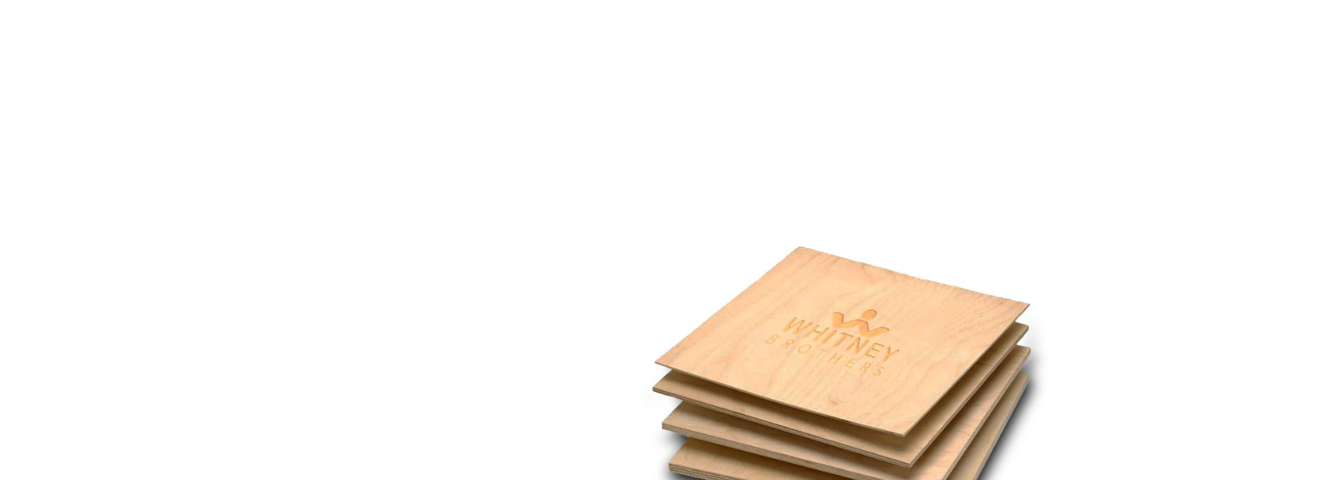 small square sheets of wood with Whitney Brothers logo imprinted